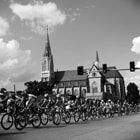 the peloton in front of a cathedral